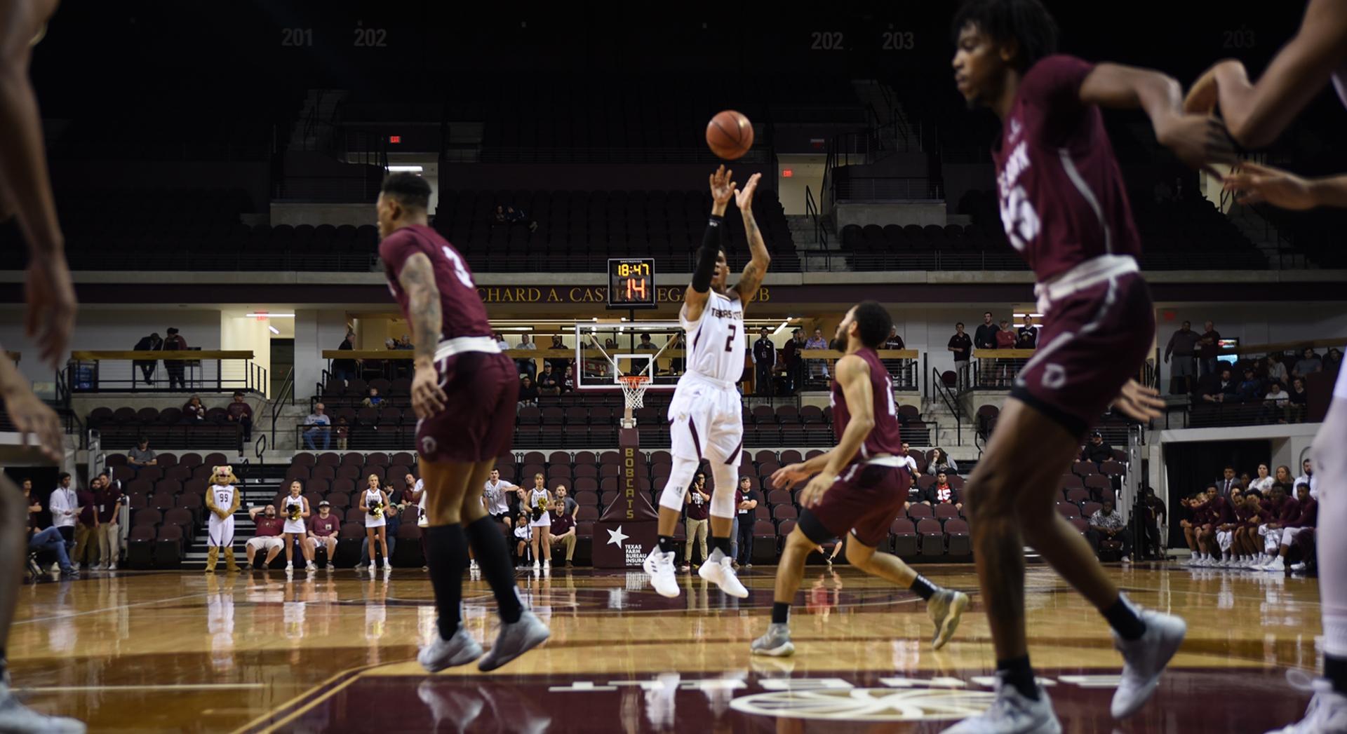 Texas State Men's basketball player Tre Nottingham for three