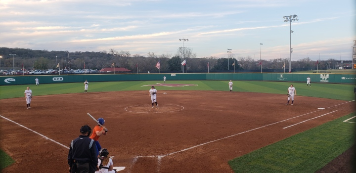 Texas State Softball on defense against Sam Houston State with several Texas State players on the field in position.