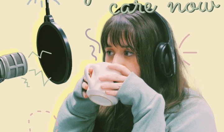 A girl with an oversized sweater and a warm mug with headphones and a microphone.