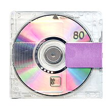 The album cover is an clear CD case with a purple stripe on it.