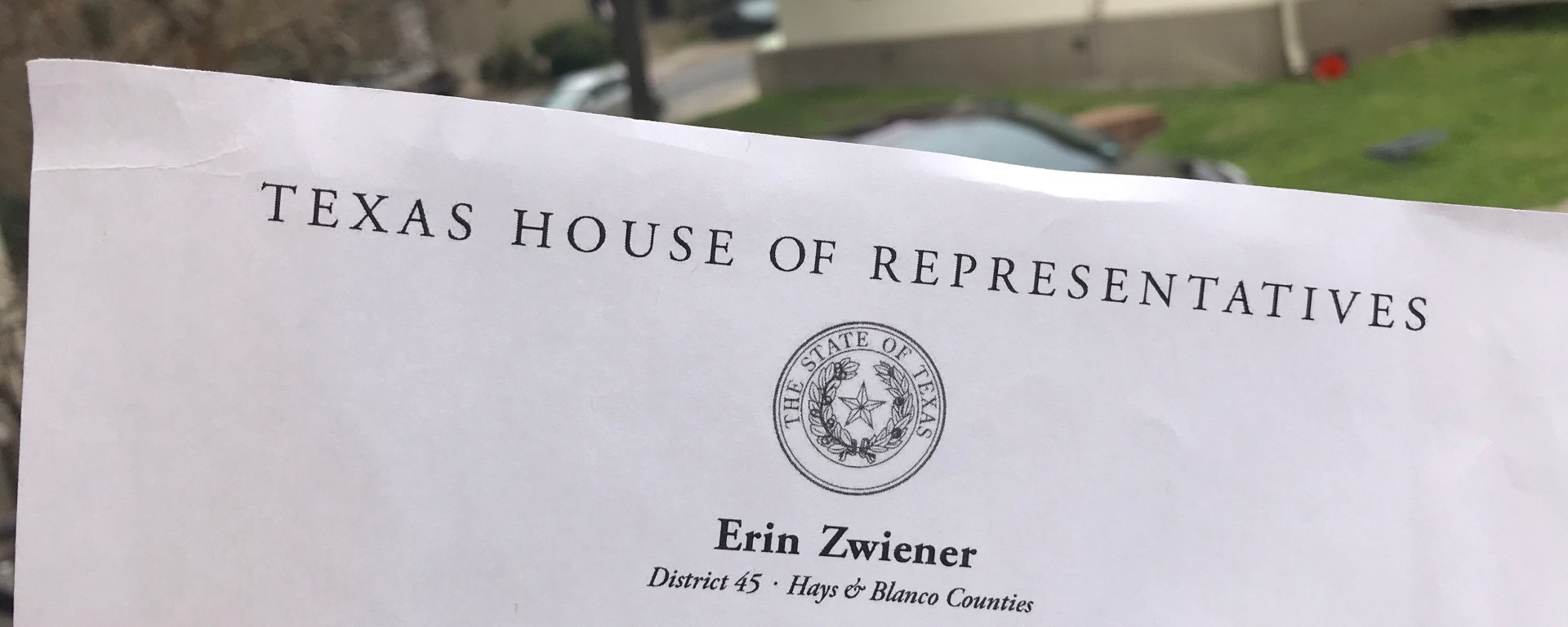 "a piece of paper outside that reads ""Texas State House of Reps"""