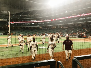 Texas State Baseball players head to the dugout.