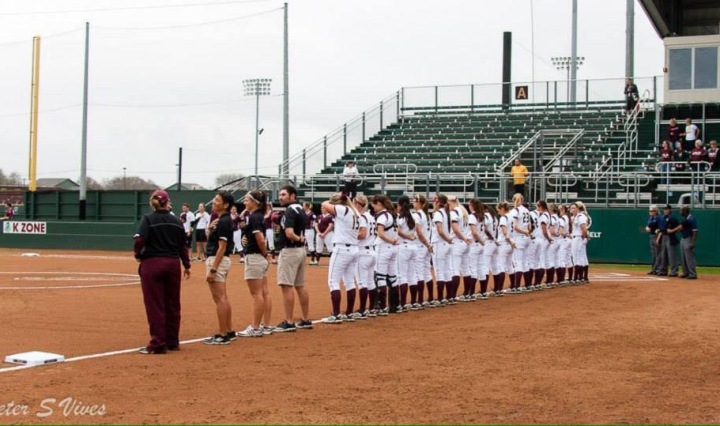 Texas State Softball stands for the pledge before game