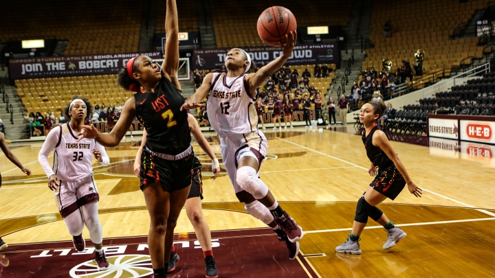 Dabrasia Baty drives to the basket for a layup against St. Thomas inside Strahan Arena.
