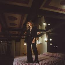 The album cover is a photo of Jessica Pratt standing on a bed with heats on the ceiling.
