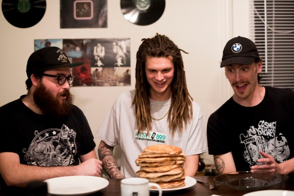 The three members of Kairos (Jake, Jacob, and Brent) gawking over a tall stack of pancakes