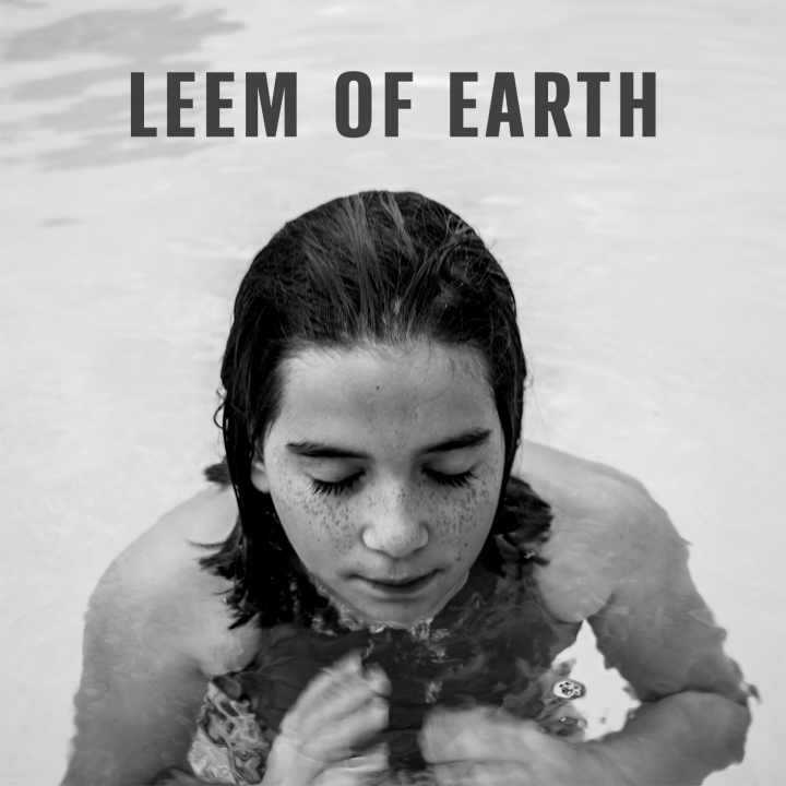 The album cover is a close-up photo of a young girl halfway submerged in the water with her head above the surface. Her eyes are closed and she has long hair and freckles.