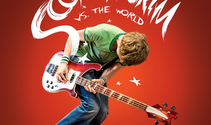 This album cover features a young man in a green t-shirt and jeans holding a bass instrument. The young man is standing in front of a red background.