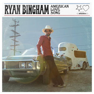 Ryan Bingham leaning on an old car in the desert for the album cover