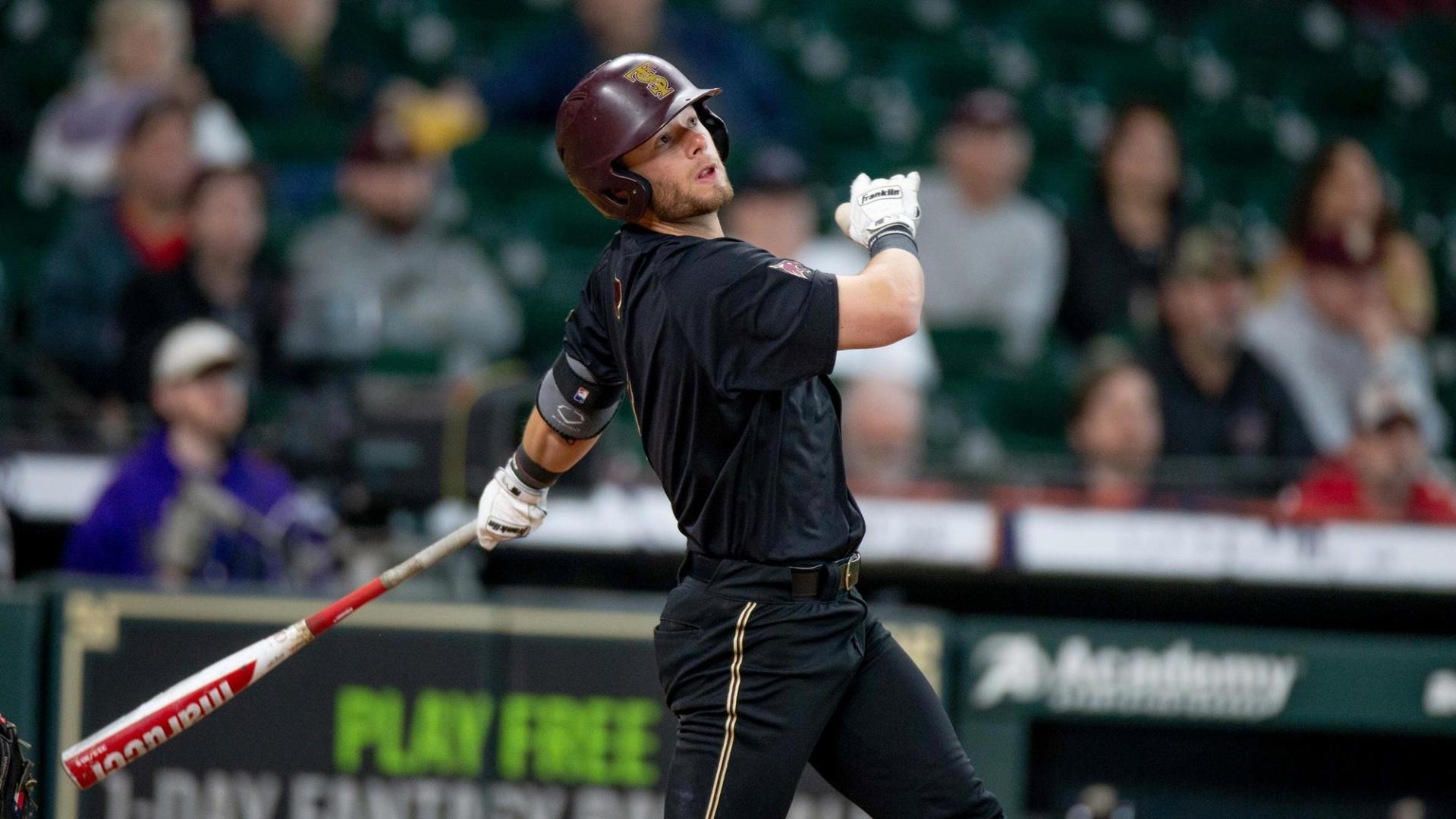 Texas State right fielder John Wuthrich swings the bat and has his eyes set on a huge hit against the Texas A&M Aggies.