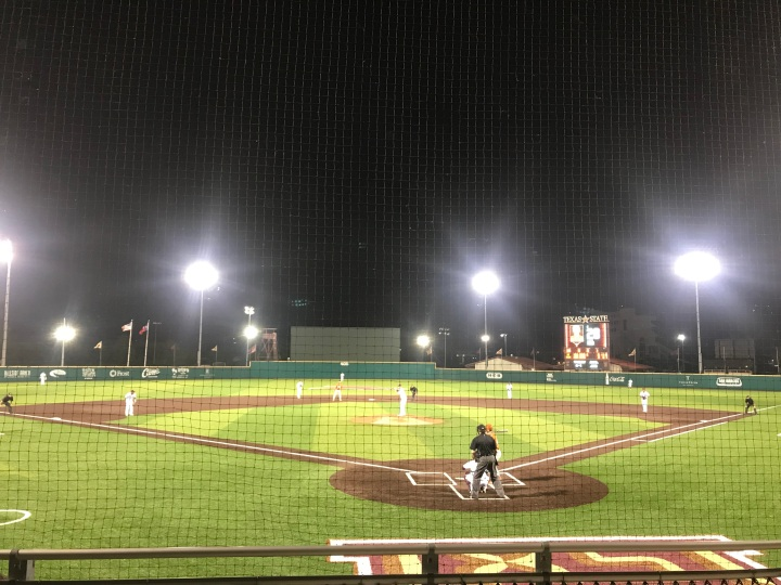 Bobcat Baseball field under the lights with players at every position.