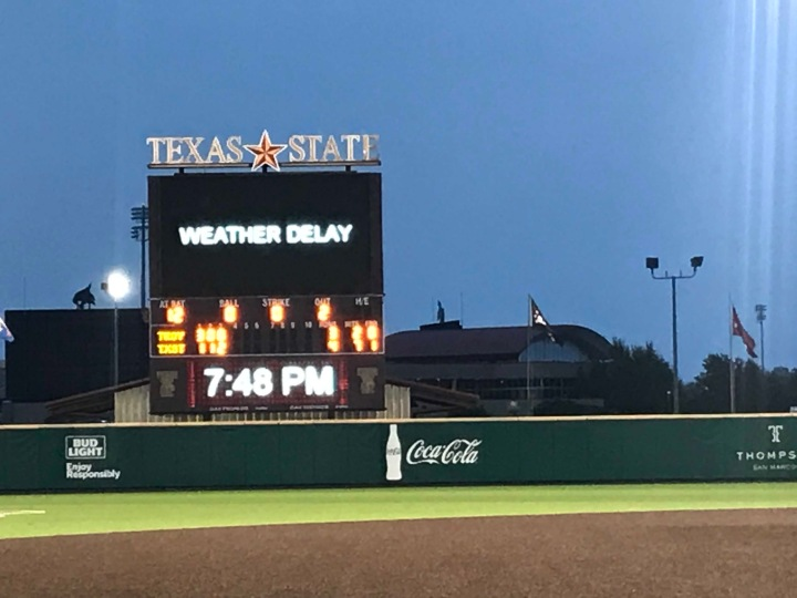 "Picture shows Texas State Jumbotron from the Baseball park. On the Jumbotron it says ""Weather Delay"" to let the fans know that the game has been paused due to inclement weather"