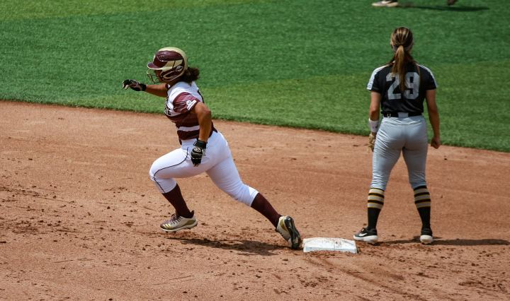 Senior outfielder Mari Cranek sprints through the bases as she heads to third as she hit her first and only triple of the day.