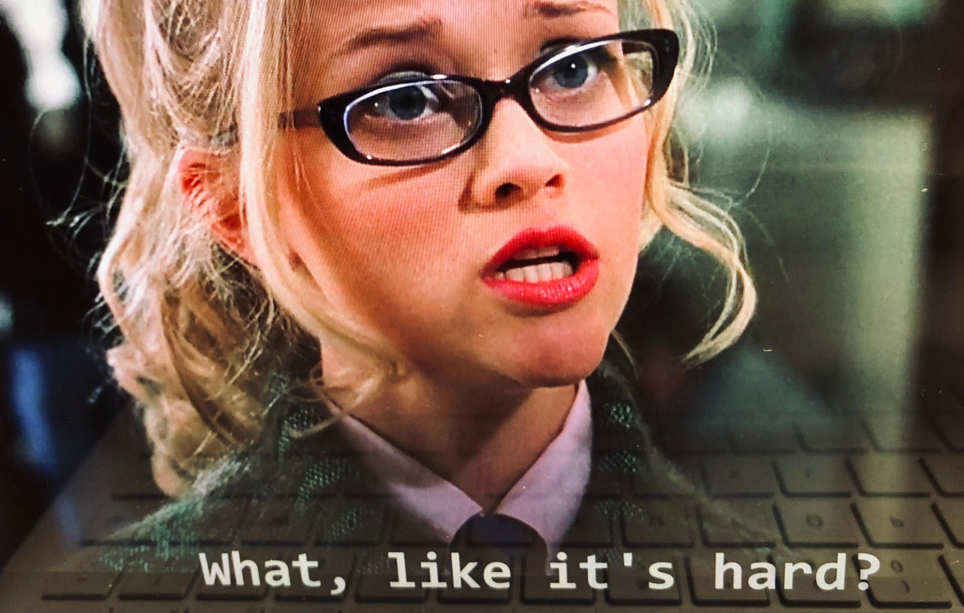 """blonde girl in glasses saying """"what, like it's hard?"""""""