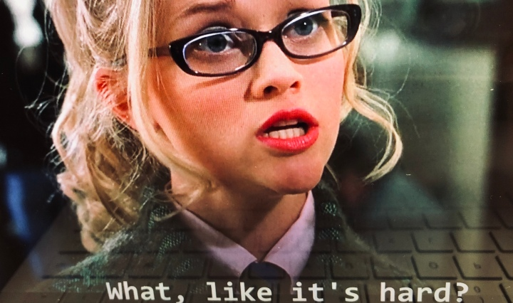 "blonde girl in glasses saying ""what, like it's hard?"""