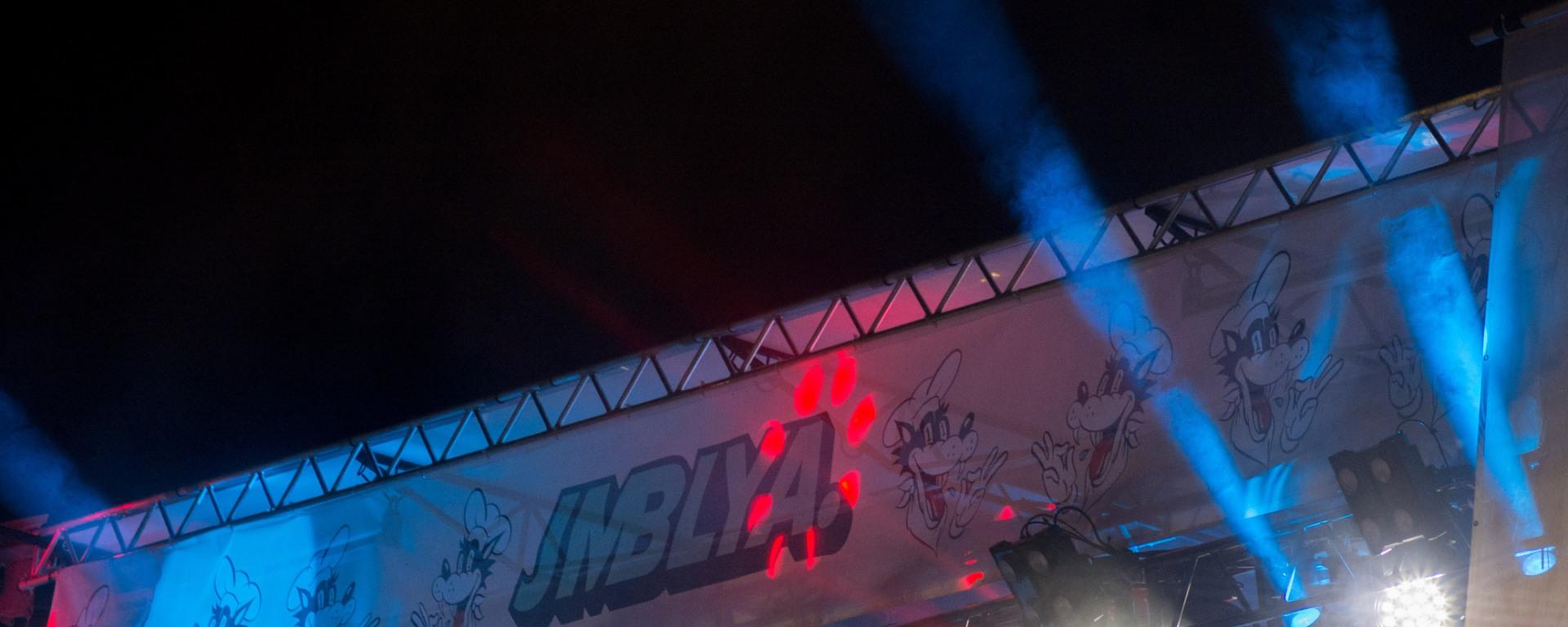 Banner for JMBLYA above a stage.