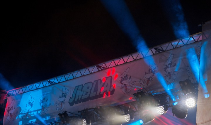 Banner for JMBLYA above a stage.