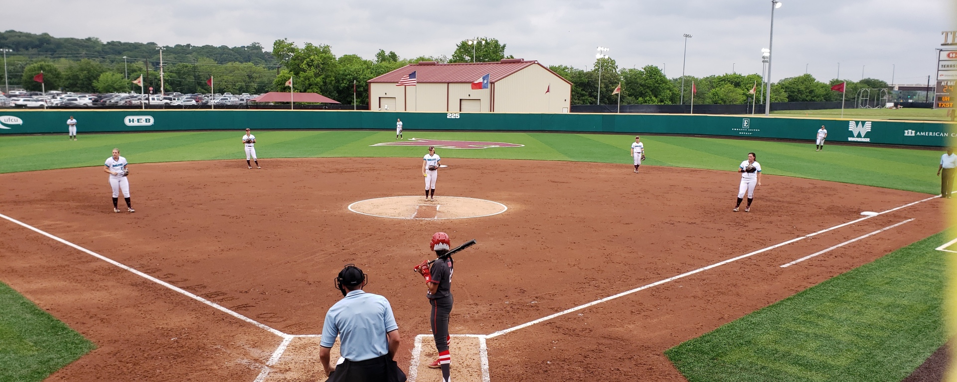 The Texas State softball team in defensive formation in-game