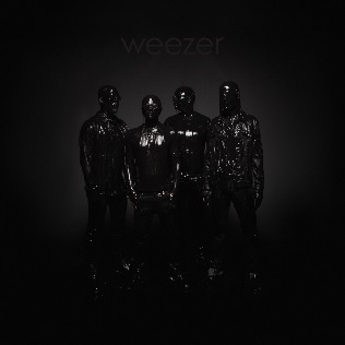 The album cover is the four band members covered in black liquid in front of a black background with Weezer in gray lettering above them.