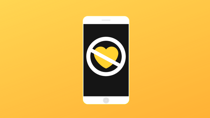 A white phone showcasing a yellow heart with a unallowed sign across it. All on a yellow background.