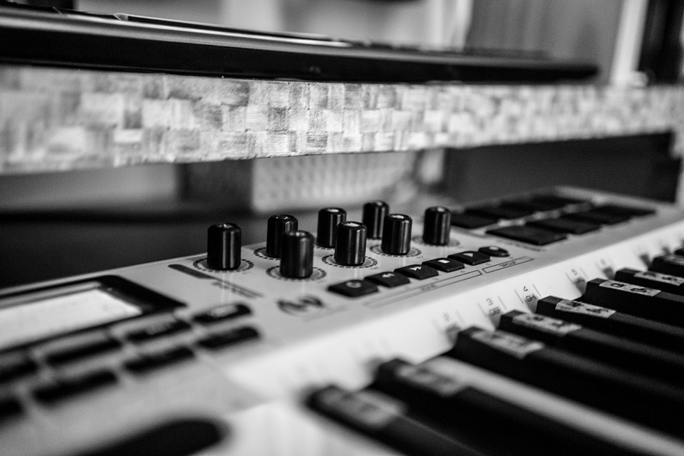 The picture is of a black and white synthesiser up close