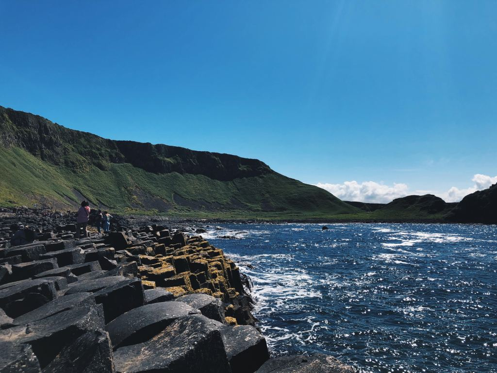 Giant's Causeway, located on the north coast of Northern Ireland, is an area with mostly hexagonal shaped basalt columns, the result of an ancient volcanic eruption. An Irish legend says that the columns are the remains of a causeway built by a giant.
