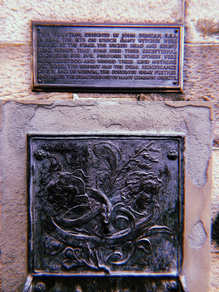 A photo of the cast iron fountain and plaque.