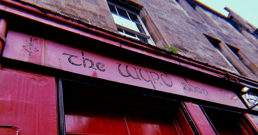 A photo of The Wyrd Shop's red storefront on the Royal Mile.