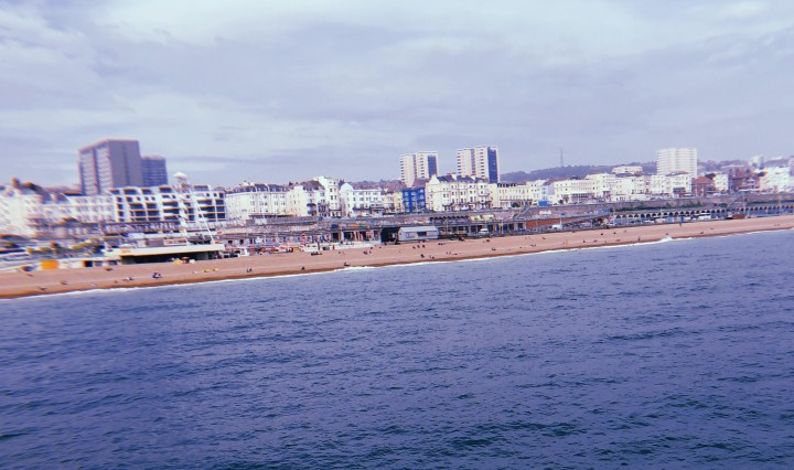 The sea and shoreline of Brighton, England taken from Brighton Palace Pier.
