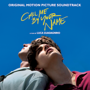 "Two men look into the sky and lean on each other and yellow text says ""Call Me By Your Name."""