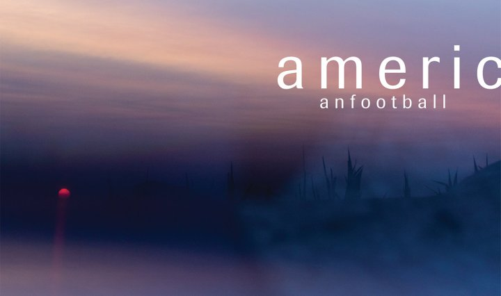 A dark blue landscape with snowy highlights is shown with a setting sun and the name American Football written in white letters near the right side of the cover