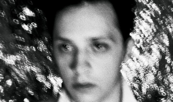 The header photo is musician Max Turnbull in black and white from his A Hound At The Hem album cover.