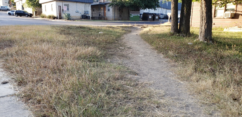 A path was cleared and the ground flattened through some grass to make a makeshift sidewalk.
