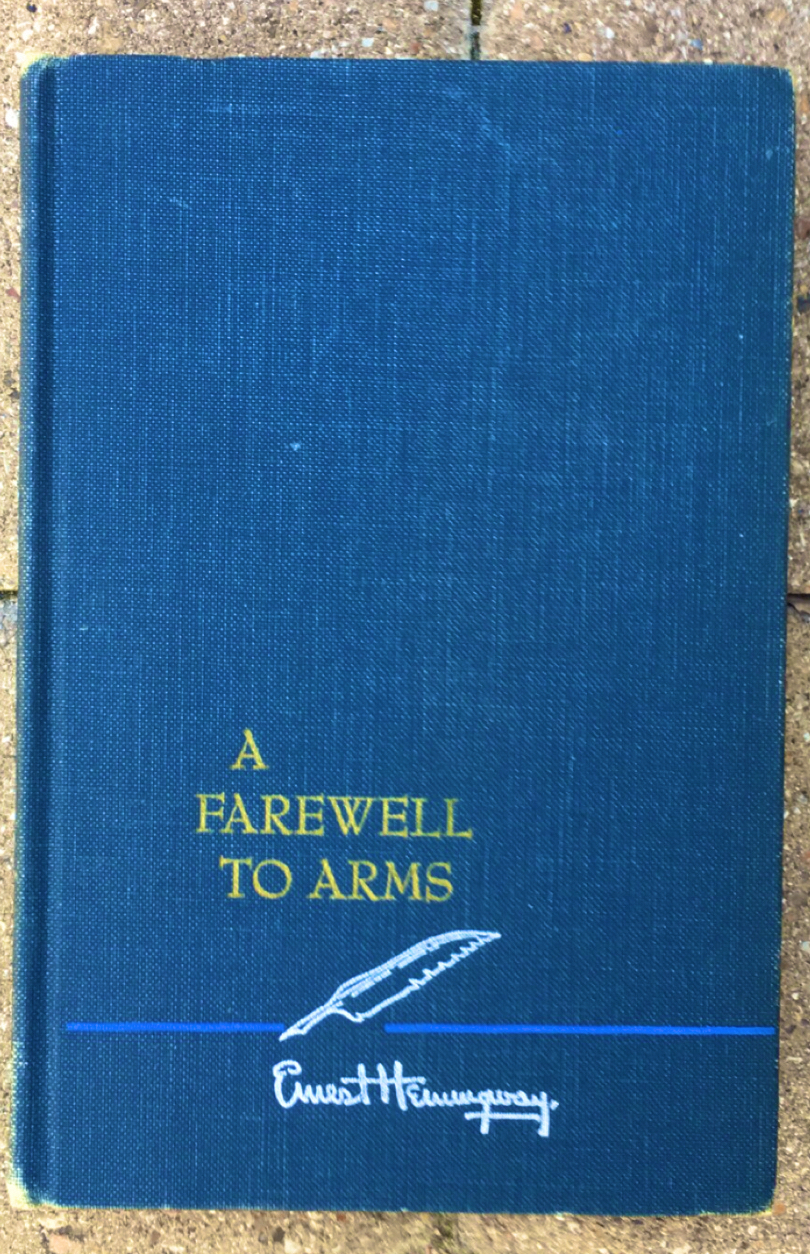 "A copy of ""A Farewell to Arms"" cover. The cover is completely blue and appears to look like a first edition."