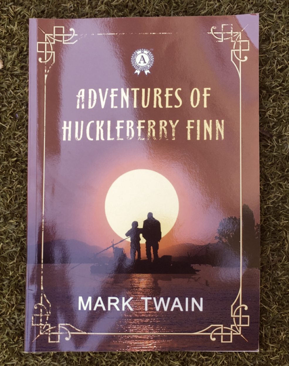 "Image of ""Adventures of Huckleberry Finn"" book cover. Edited to have brown hues."