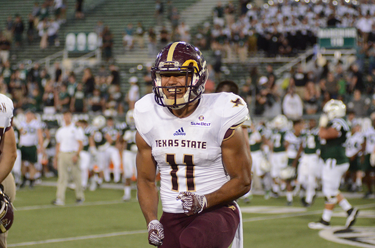 Texas State defensive end Ishmael Davis celebrates on the field during a football matchup against a non-conference opponent.