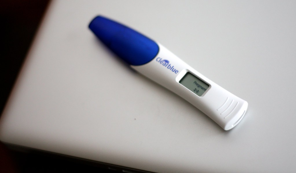 Blue and white positive pregnancy test