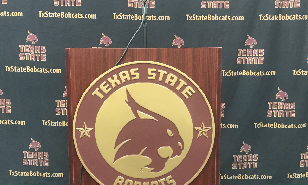 Picture of a podium with the Bobcat Logo on the podium.