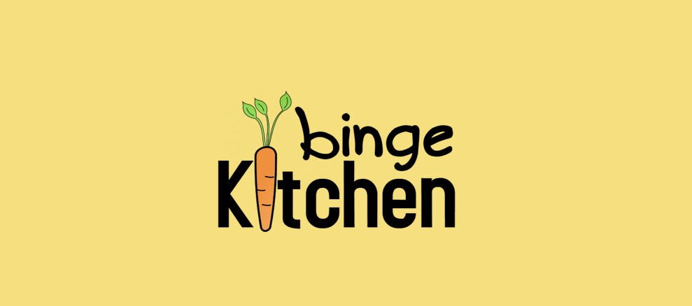 "A yellow background with the words ""Binge Kitchen,"" the i in Kitchen being an orange carrot"