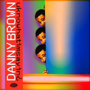 Danny Brown is peaking from behind a colorful screen in front of other colorful screens. On the left side it says, vertically, uknowhatimsayin¿ by Danny Brown