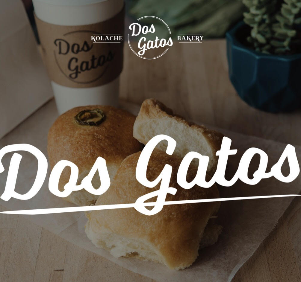 The words Dos Gatos in white lettering and a small Dos Gatos logo over a picture of kolaches and coffee.