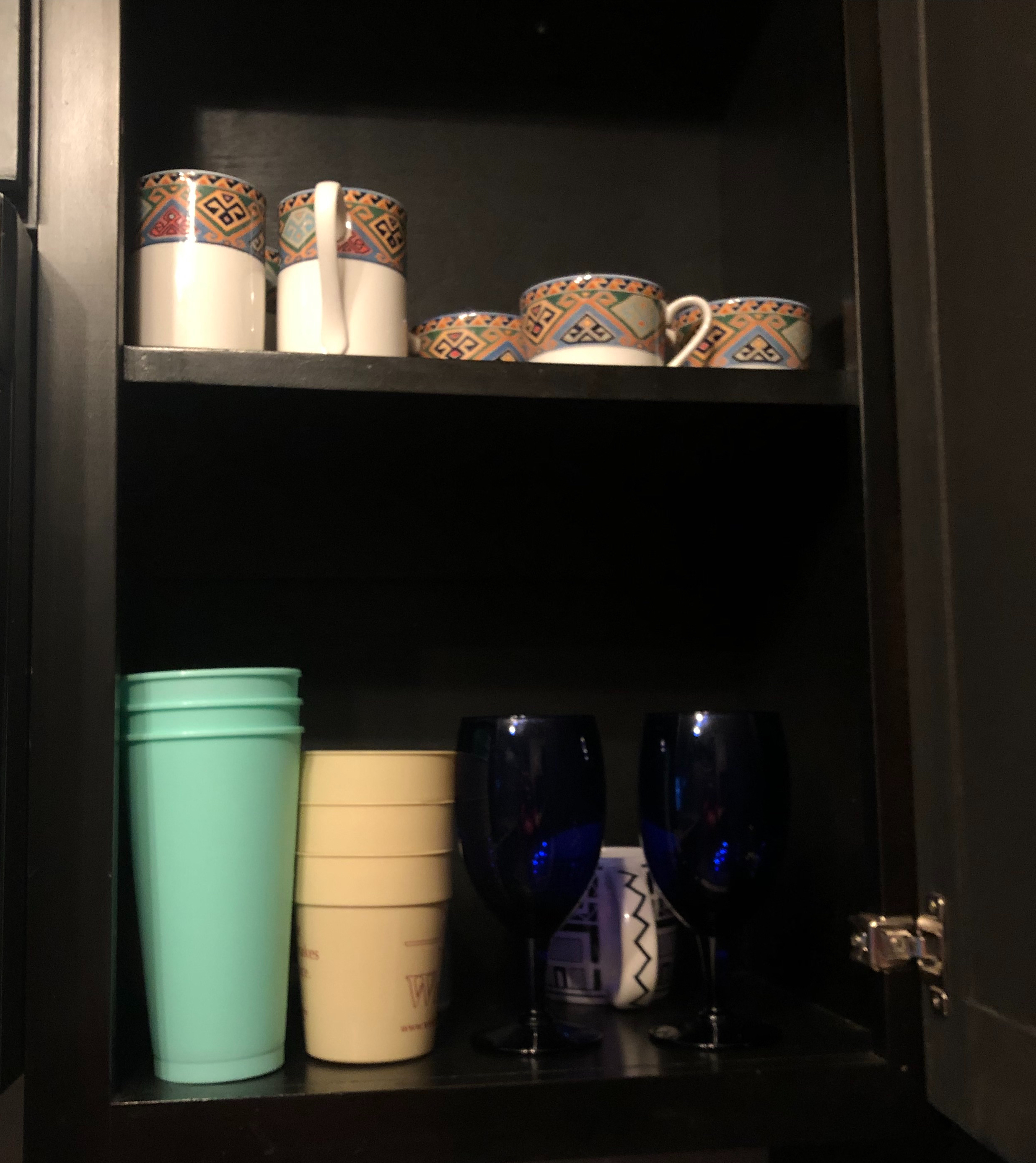 This is a picture of my kitchen cabinet after I spent time organizing it so that way my roommates and I could have easier access to certain cups we might want to use. This is especially good to do on Sunday, so that during the week we don't have to bother.