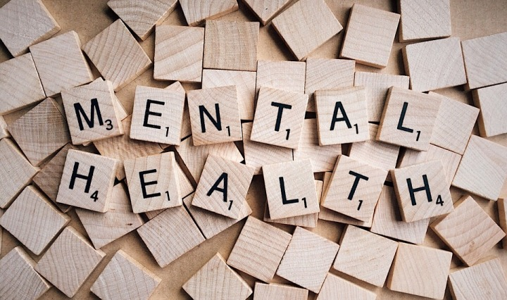 "Scrabble tiles spelling out ""mental health."""