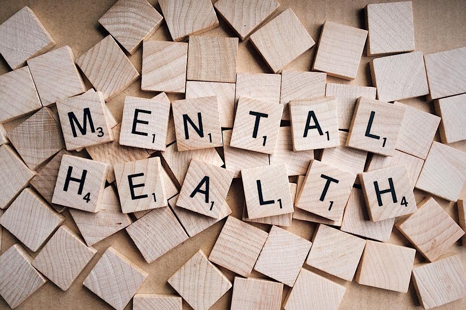 "Scrabble tiles spelling out ""mental health."""