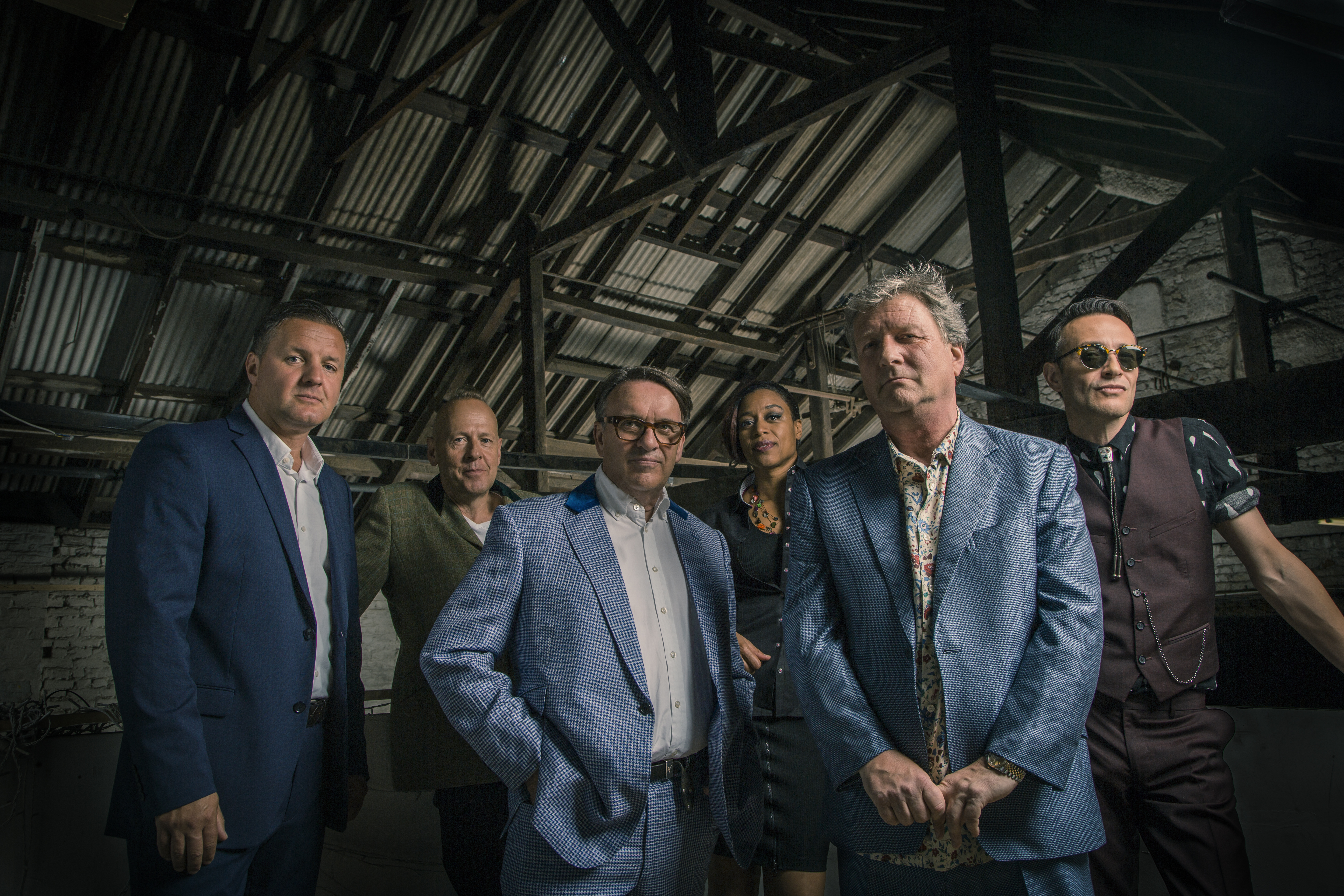 Members of the band Squeeze, five male, one female