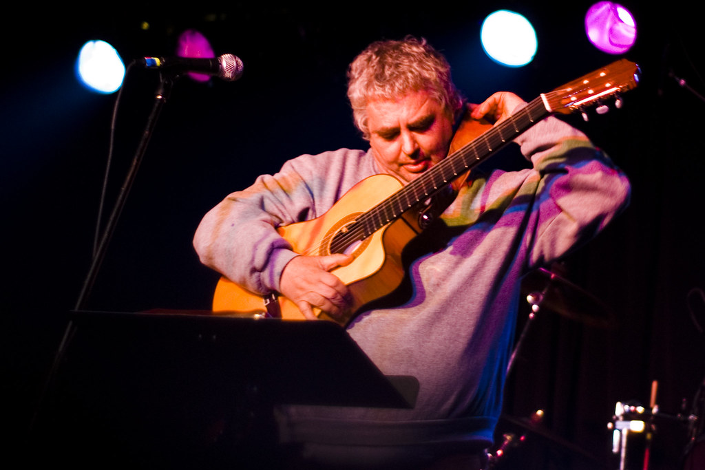 Daniel Johnston putting his guitar strap over his neck
