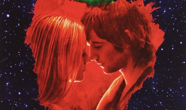 An album cover with a rigid strawberry over a night sky. In the strawberry are the male and female love interests from the movie looking towards each other. At the top of the album are the words Across the Universe: music from the motion picture in large font.