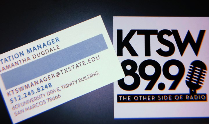 A business card with Sami's contact information and a KTSW sticker