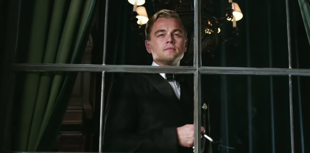 Leonardo Dicaprio (The Great Gatsby) stands in his house looking down from his window.