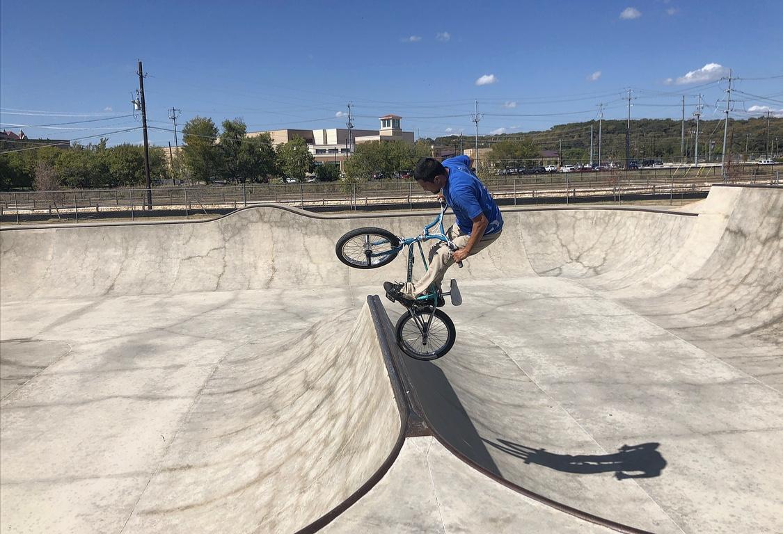 A BMX rider hitting a jump at the San Marcos Skate Park.